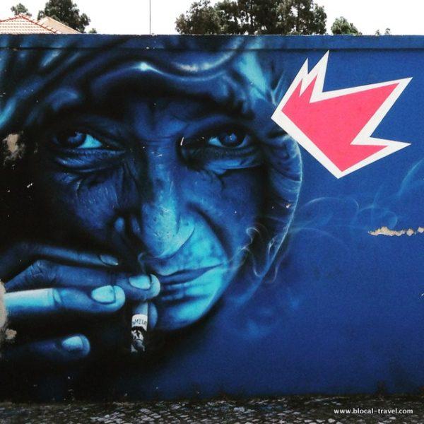 smile blue wall street art lisbon
