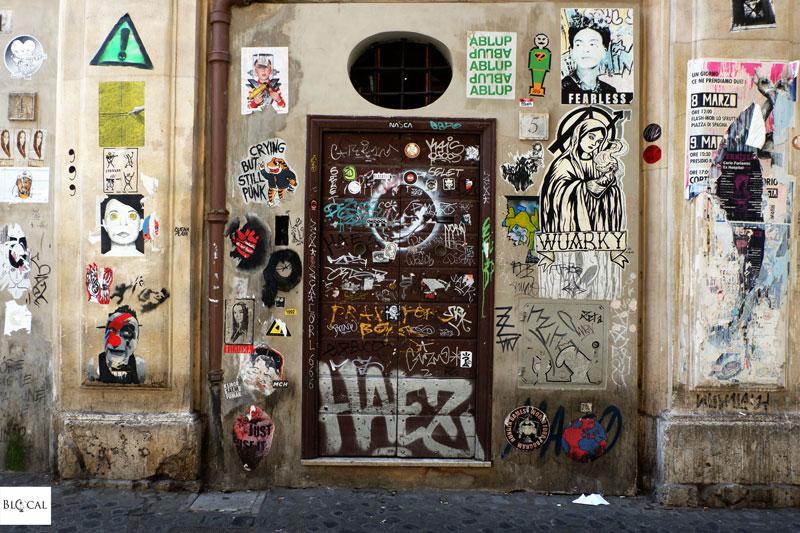 trastevere street art poster via della Lungaretta