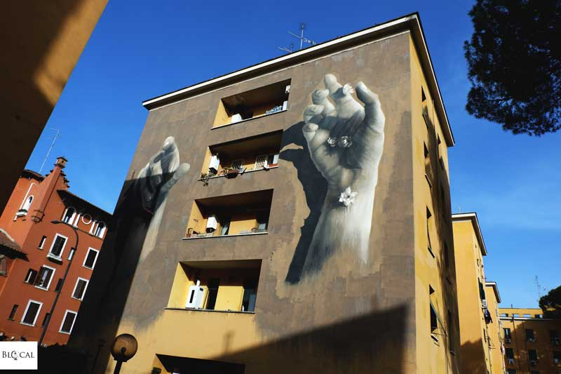 Gomez mural street art in Garbatella neighbourhood Rome