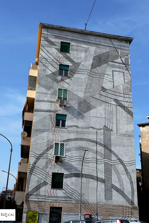 Sten Lex mural street art in Garbatella neighbourhood Rome