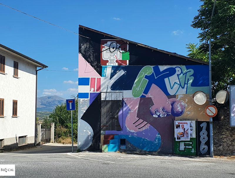 Sawe Borgo Universo mural Aielli street art Italy
